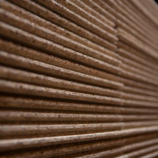 Close up of wooden boards stacked up